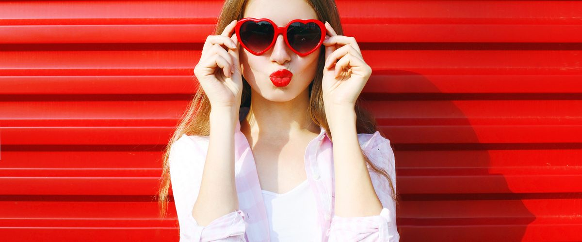 Pretty,Woman,In,Red,Sunglasses,Blowing,Lips,Kiss,Over,Colorful